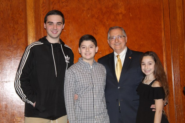 Dominic Garofalo, James Atsales and Arianna Atsales congratulate their grandfather Arthur Guinasso on being elected 2019 City Council President on Monday at City Hall.