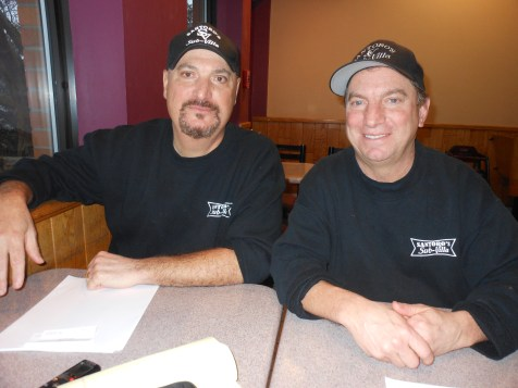TAKING A BREAK: Left to right, brothers Rich and Rob Santoro relax during an interview this week at Santoro's Sub-Villa on Essex Street off of Route 1 in Saugus. The brothers recently announced to their customers that they are calling it quits on or about Feb. 3, ending more than six decades of family ownership through three generations. (Saugus Advocate Photos by Mark E. Vogler)