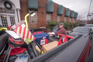 Santa's helper, Frank Raduazzo, filled his pickup truck with gifts.