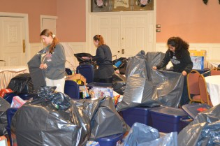 Many MVRCS Key Clubbers were elves for the evening. The baskets overflowed and large plastic bags became Santa's sack.
