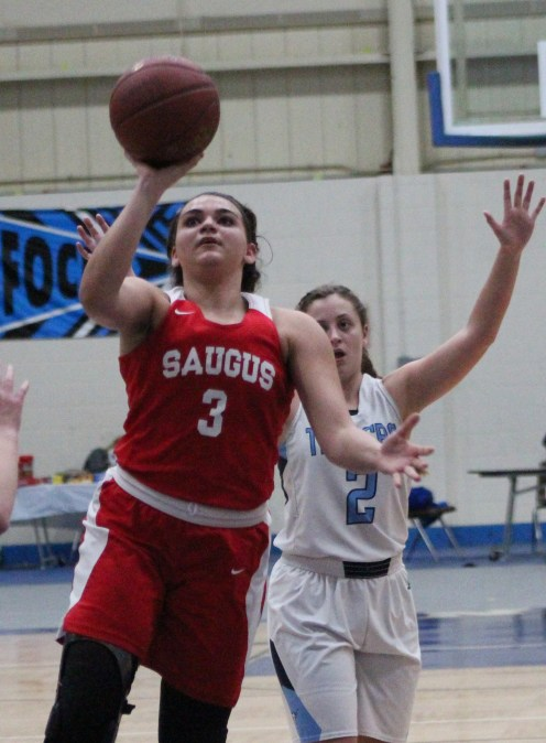 Saugus forward Marissa Stockwell goes up for a shot against Peabody.