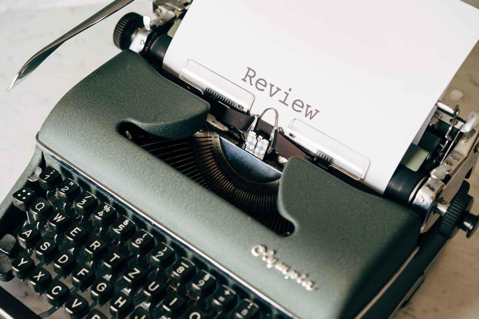 black and white typewriter on table