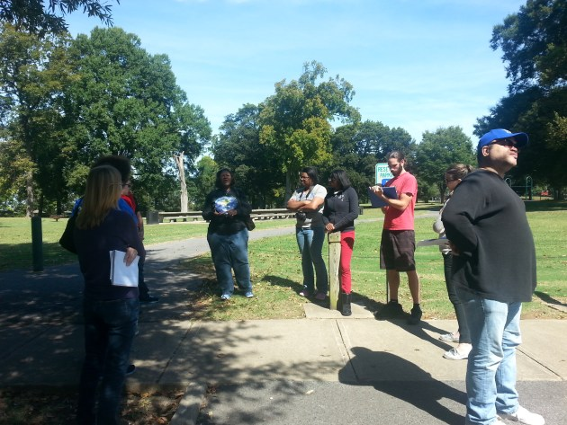 Rita Harris speaks with students from two anthropology classes about industrial hazards surrounding Martin Luther King Jr. King Park on a toxic tour