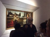 "Art History professor lectures in front of Leonardo's ""Annunciation"" in the Uffizi Gallery of Florence"