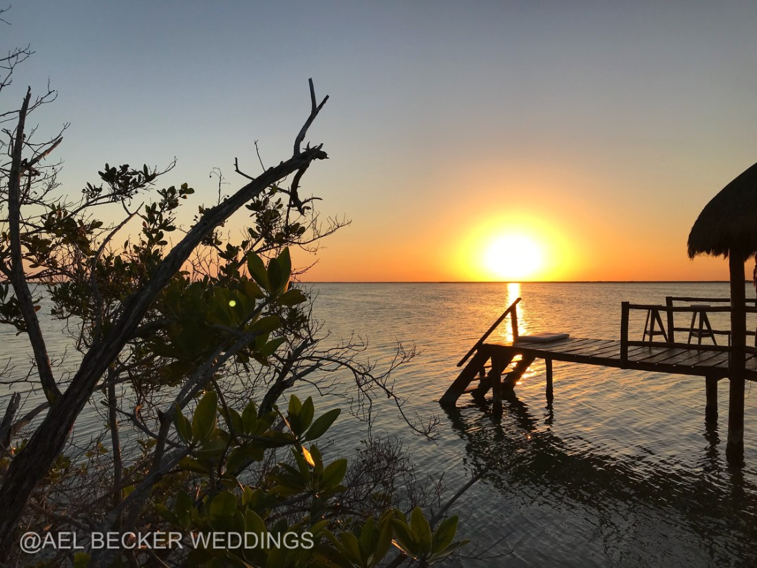 Sunsets from Mukan Resort's lagoon pier. Sian Ka'an Mexico. Ael Becker Weddings