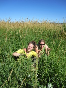 Lacie and Sarah make their way through the invasive grass.