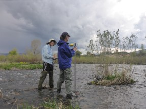 Paula and Suzanne take velocity measurements across the stream.