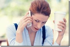Upset sad, skeptical, unhappy, serious woman talking on phone