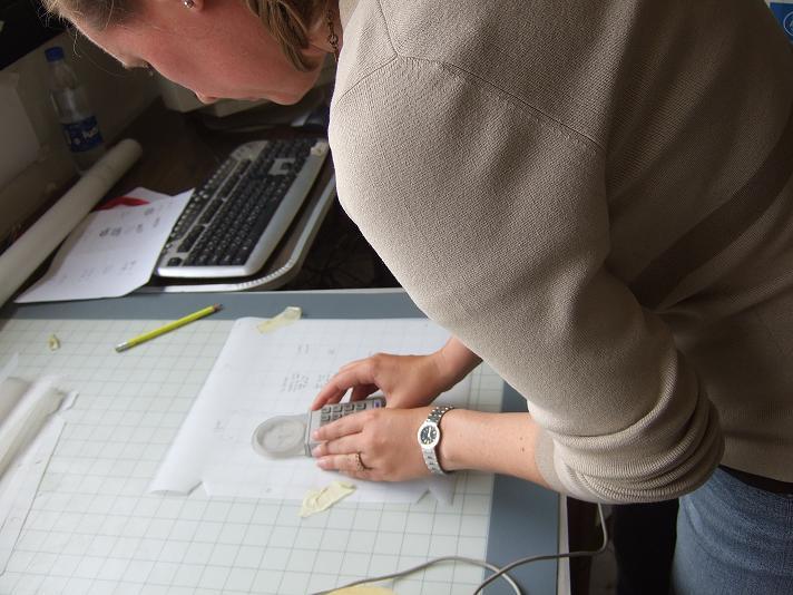 Amy McMahon digitizes hand-drawn site maps for GIS.