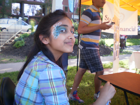 Face Painting at an Asian Indian booth.