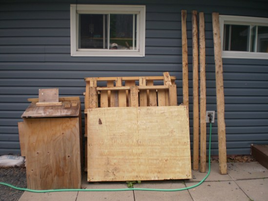 Pallets, lumber & garbage can cover.