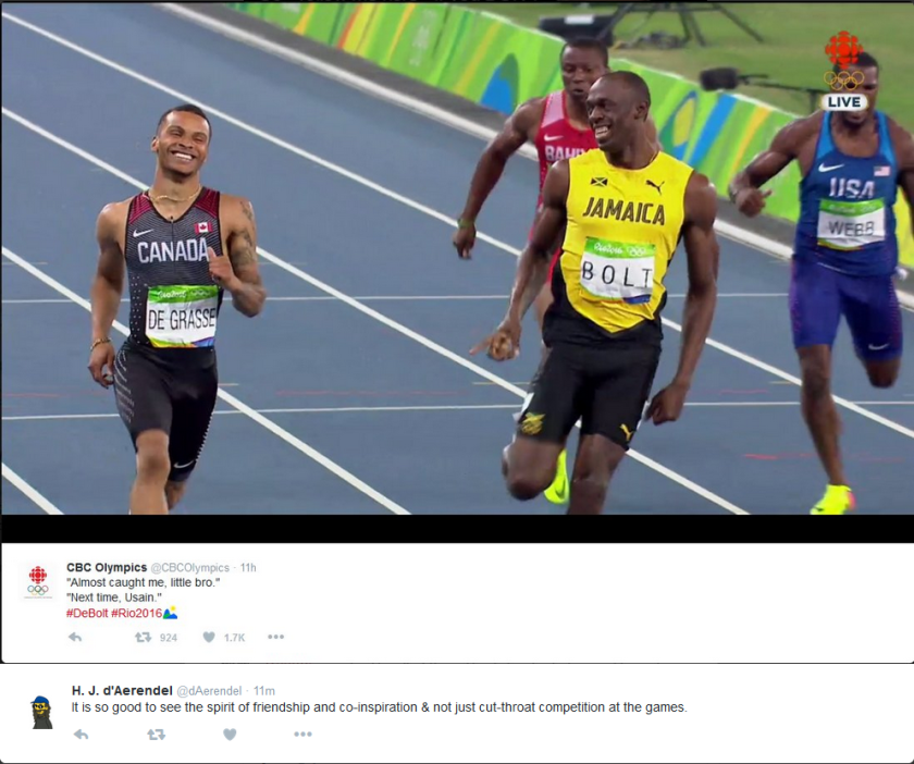 DeGrasse & Bolt smiling at each other.