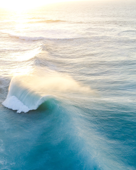 Wedge Wave Formation Rolling Through Ocean