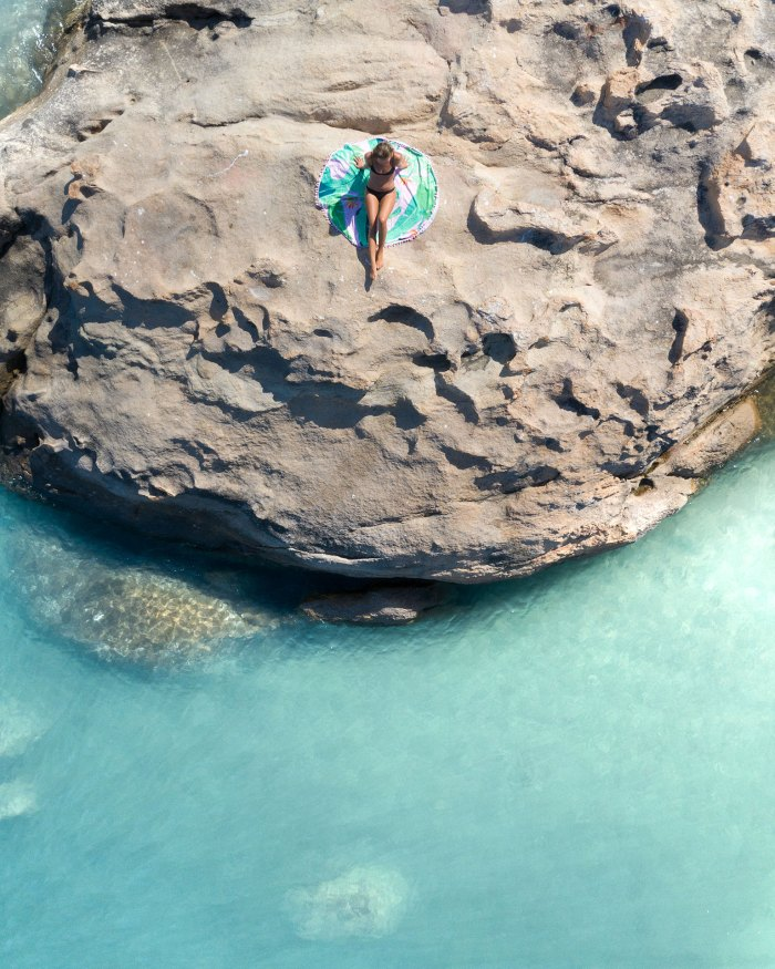Tropical Aerial Photo Of Girl On Rock