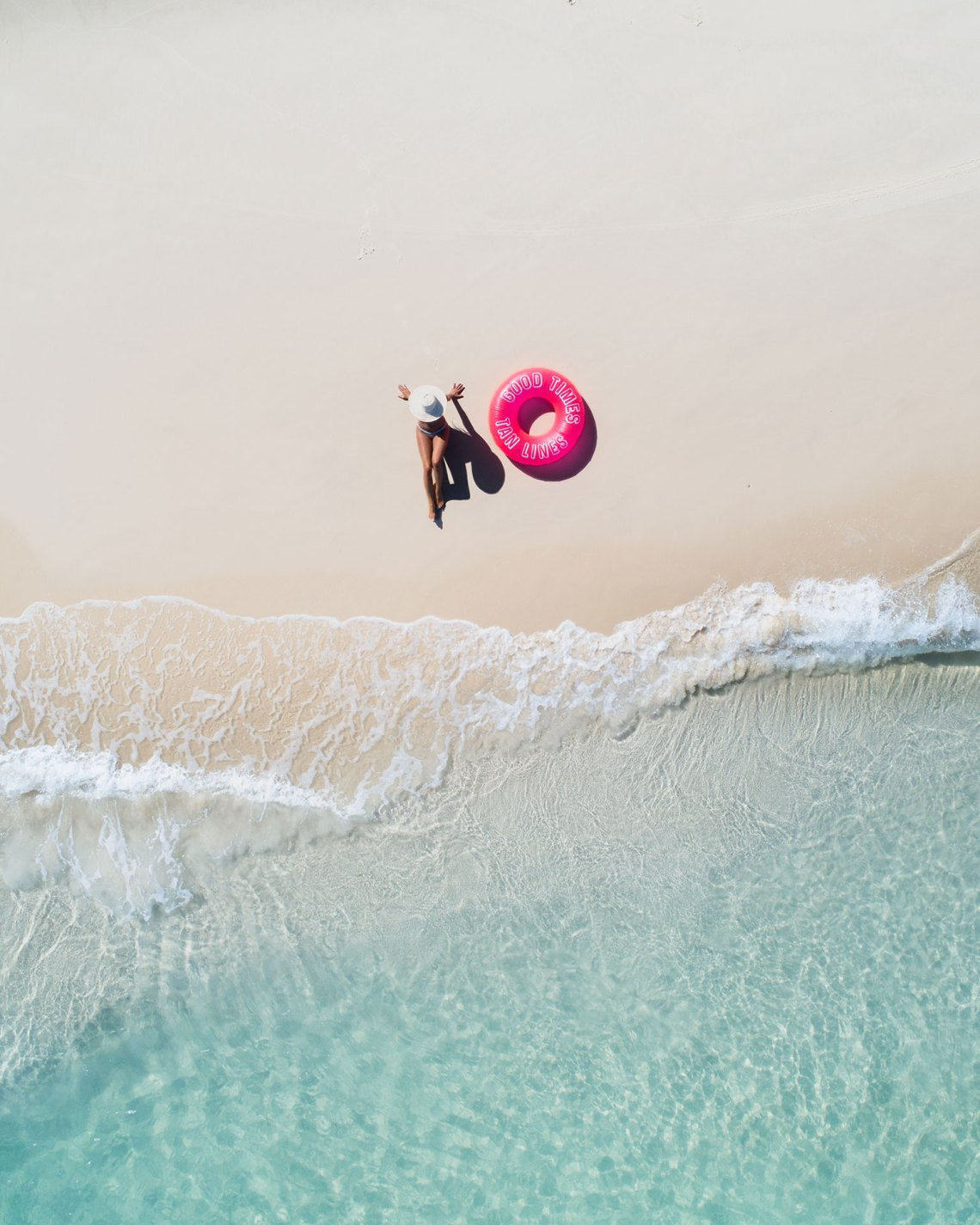 Aerial Of Girl On Beach With Sunnylife Pool Ring
