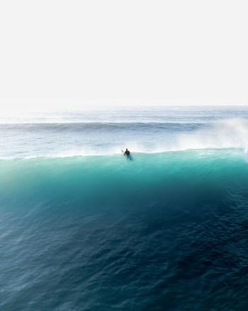 A Lone Surfer Battles The Big Blue Waves