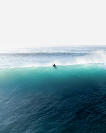 A Lone Surfer Battles The Big Blue Waves