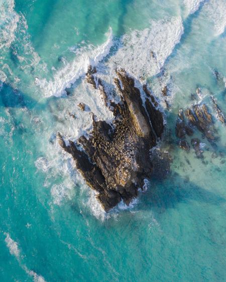 Broken Head Main Rock Surrounded By Dreamy Blue Water