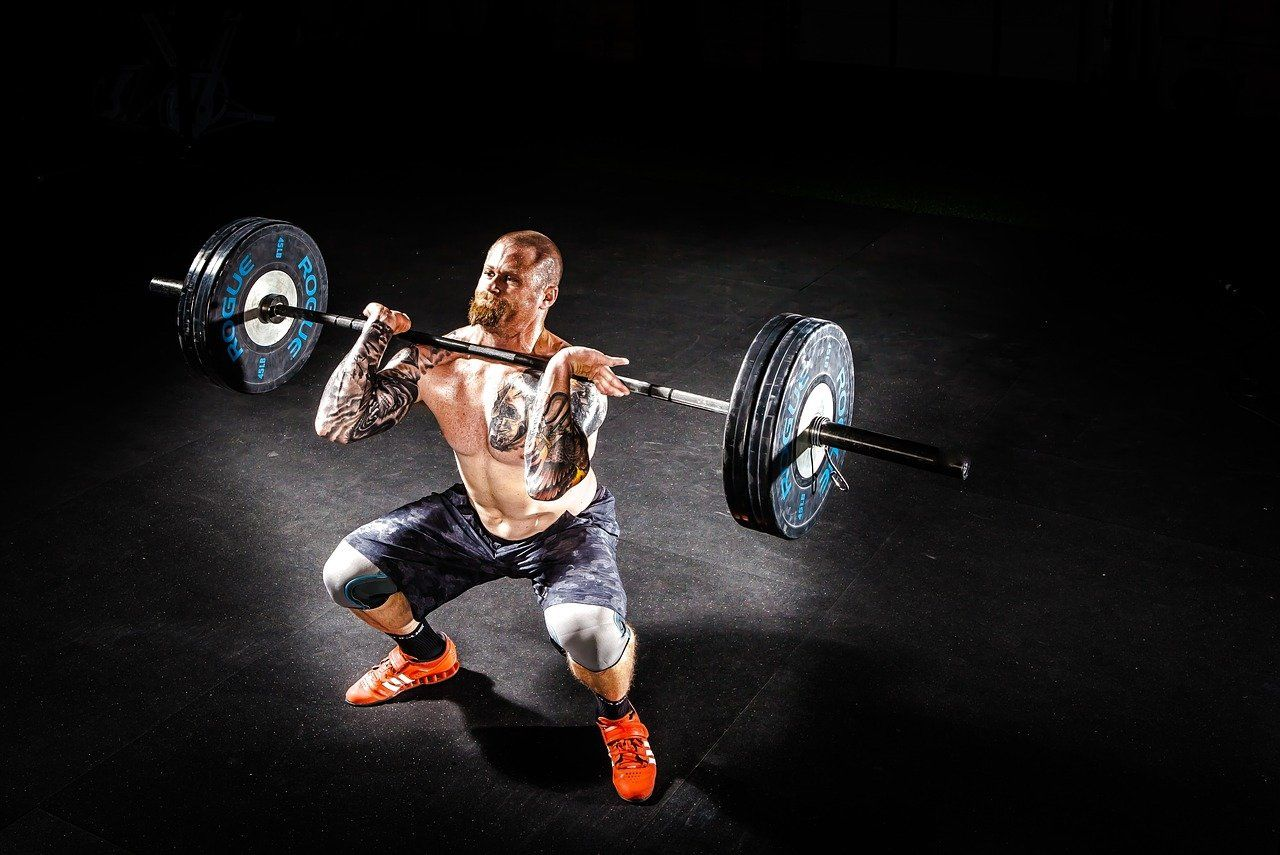 barbell overhead press man exercise