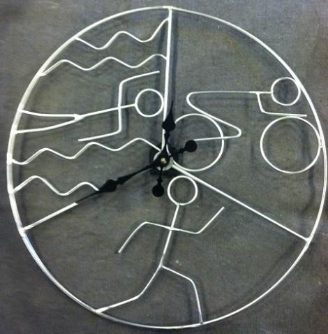 http://www.metalartistforum.com/maf/index.php?/topic/7323-triathlon-art-clock/