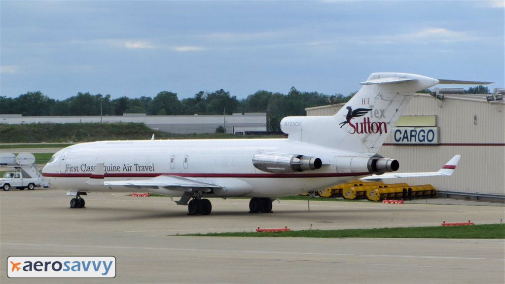 An old white 727 with a red stripe sits on the cargo apron in Louisville, Kentucky.  AeroSavvy