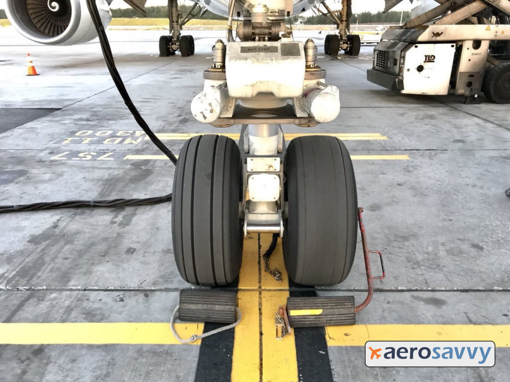 Nose gear of a 767. One nose wheel is new, the other is older. Grooves are almost gone indicating the tire will need to be replaced soon.