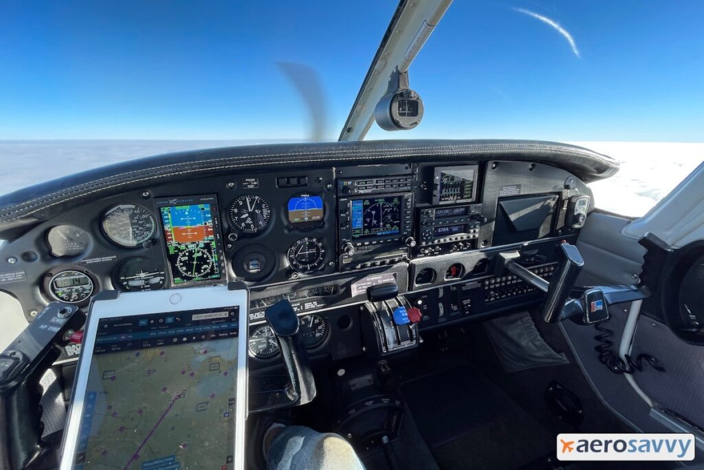Inflight view of our instrument panel. iPad with moving map is mounted to the left control yoke.