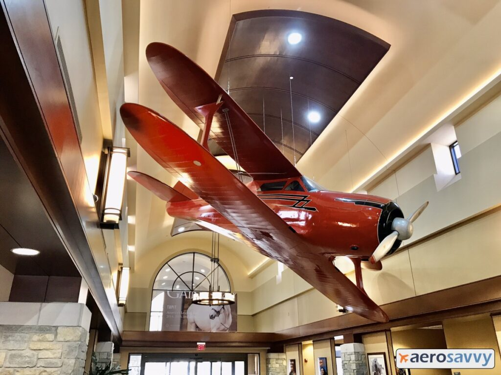 red biplane hanging from the ceiling of the lobby.