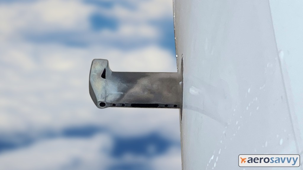close up of the TAT probe. Probe is about 6 inches long and sticks out of the side of the aircraft. shaped like a small wing. at the end of the wing is a tube aligned with airflow so air can enter the move through the tube