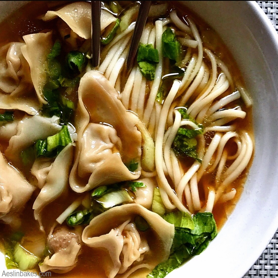 Wonton soup with noodles and bitter greens