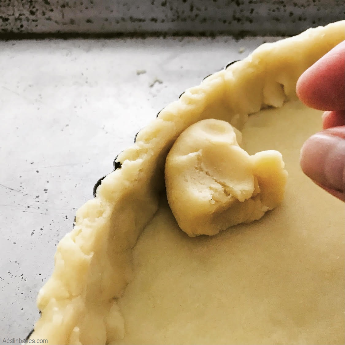 pressing in sweet pastry dough with dough