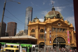 Tram in front of the iconic Flinders Street Station, VIC