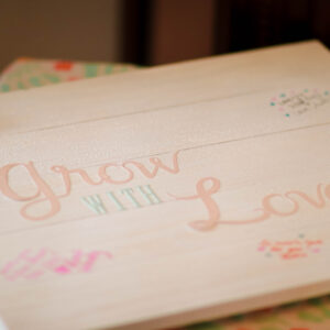Grow with love sign