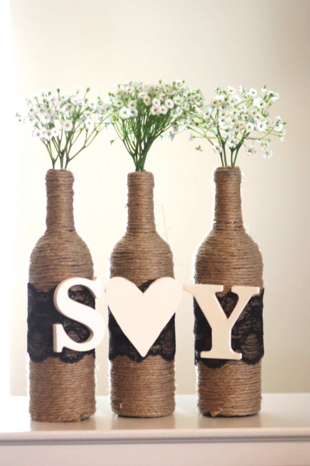 Rustic Wine Bottle Centerpiece | 3 Wrapped Wine Bottles with Two letters and Heart | Custom Colors of Lace and Letters Included