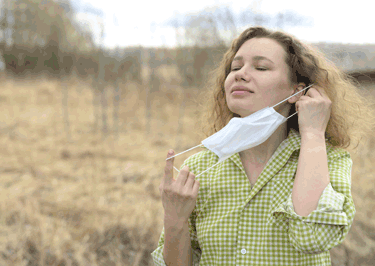 Woman with Mask Getting Fresh Air