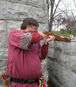 Master Urho shooting from the parapet of the castle