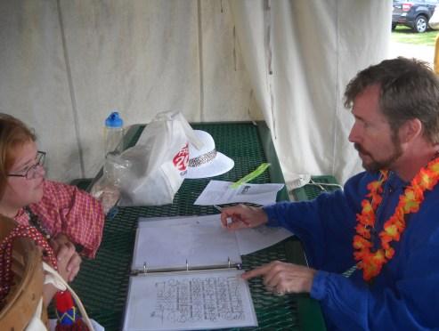 THL Kieran MacRae shows THL Anlaith a Flourished Hand by Bocskay (Photo credit: Mistress Hilderun)
