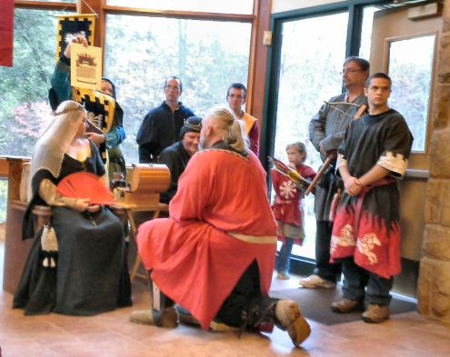 Sir Thorgrim receives his scrolls and those of Sir Vlad. Photo by Arianna.