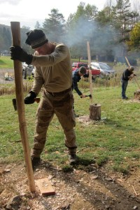 Using a hatchet to rough out the bow shape.