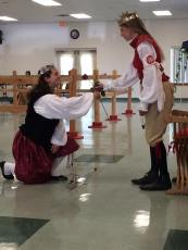 Countess Elena receives a rose from Her Majesty before the tournament. Photo by Lady Antoinette de Lorraine.