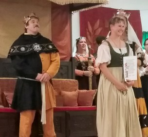 Bekah of Sylan Glen receives a Silver Sycamore. Photo by Mistress Arianna.