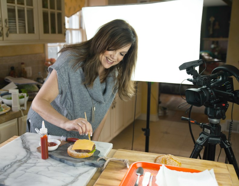 Jennifer Janz styling a cheeseburger on the set of a video shoot
