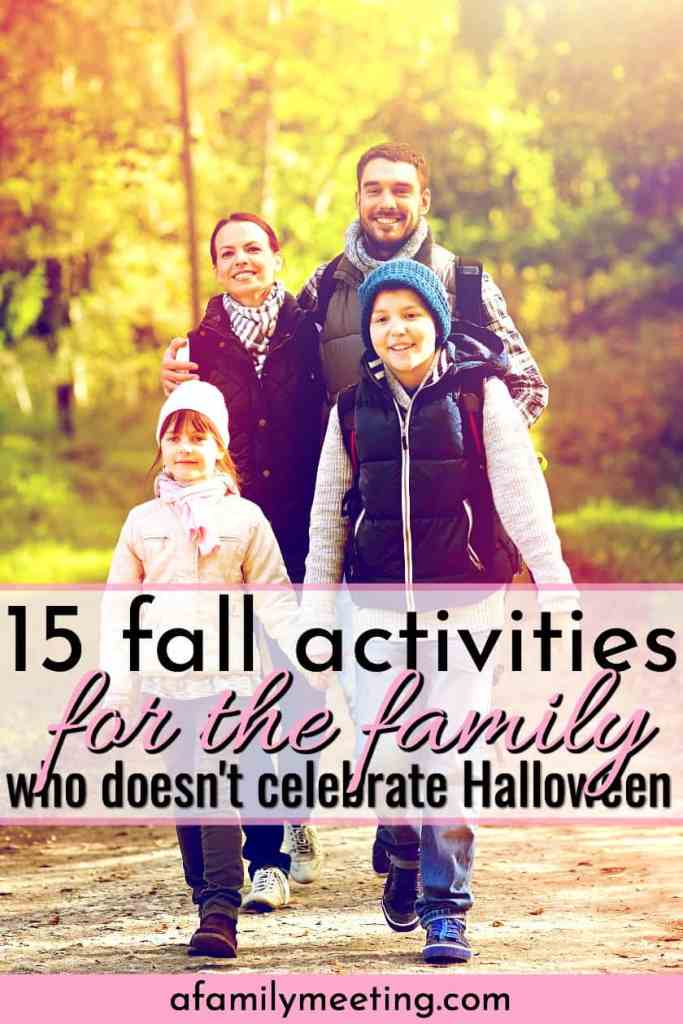 family of 4 walking hand in hand in the fall looking for fall activities for the family who doesn't celebrate Halloween