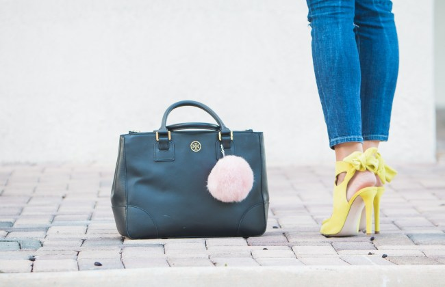 miami fashion blogger amanda tur wearing a style mafia crotchet black top with siwy denim distressed tory burch robinson black bag with pink pompom pouf bag accessory yellow zara sandals with bow tie and pink lips a fancy affair blog
