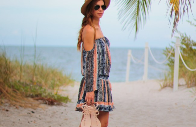 amanda tur a fancy affair miami fashion blogger wearing a mini boat hat with the rebecca minkoff mini hot pink bag rockstud jelly sandals at the ritz carlton key biscayne miami florida off the shoulder and waist drop flowy dress kendra scott tassel necklace turquoise