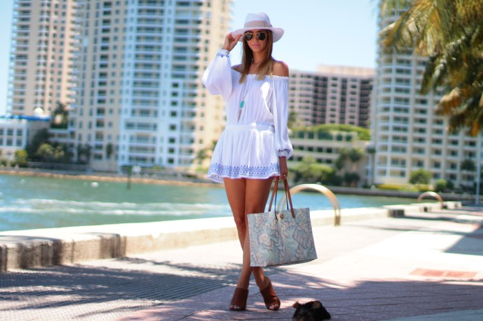Imiami fashion lifestyle blogger amanda tur from a fancy affair wearing a lulus.com off the shoulder dress, new tory burch coral drawings bag, H&M panama white and pink hat, kendra scott necklace with yorkie toy dog yorkshire and target mules mossimo sandals perfect for summer and spring