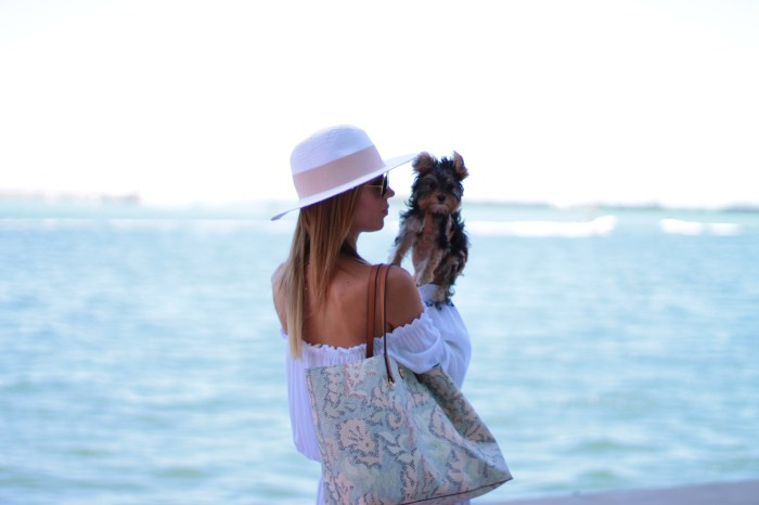 miami fashion lifestyle blogger amanda tur from a fancy affair wearing a lulus.com off the shoulder dress, new tory burch coral drawings bag, H&M panama white and pink hat, kendra scott necklace with yorkie toy dog yorkshire and target mules mossimo sandals perfect for summer and spring