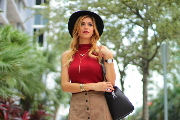 amanda tur a fancy affair fashion blogger brazilian and miami suede button down skirt with red turtleneck top with black booties henri bendel satchel bag and 6 months yorkie