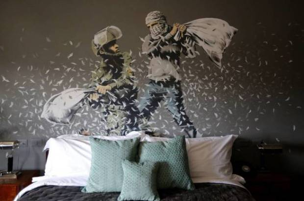 heb01-bethlehem-04-03-2017-an-artwork-depicting-an-israeli-soldier-l-and-a-palestinian-protester-during-a-pillow-fight-by-british-street-artist-banksy-is-painted-onto-a-wall-in-a-bedroom