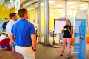 Event participant shares group findings from breakout activity.